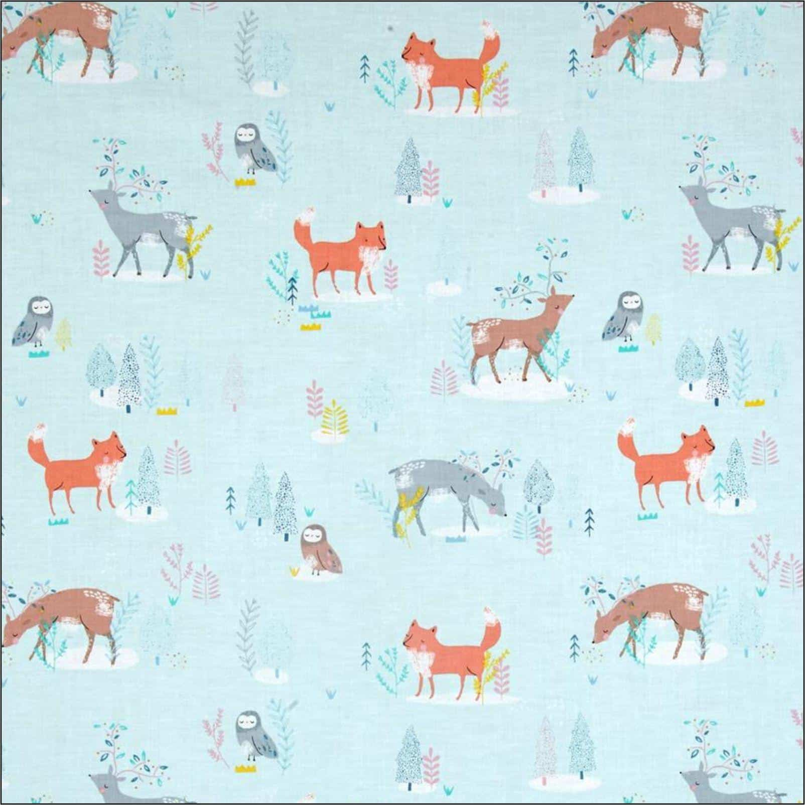 P:ine Grove animals on pale blue. Cotton fabric for dressmaking from More Sewing